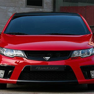Kia Forte Coupe and Sedan Road runs grill